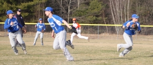 Shortstop Colby Ingraham prepares to throw home to get a key out in the fifth inning
