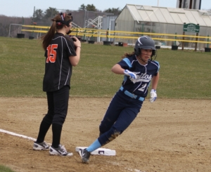 Rylee Culverwell rounds third and heads in with the second Vikings run