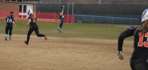 Jill Lombard (#13) hits a 2-run double over the glove of Rachel McCarthy in center in the third.