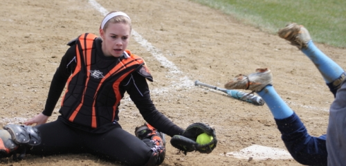 Catcher Molly Mello after tagging Cori Simons for the final out.