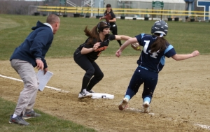 Ashley Shute picked off third by Kaycee Lemorosky as Triton coach Jim Hounam looks on