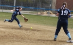 Alexa Reilly reaches for a grounder