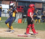 Rachel Buzzotta steps on home in the first inning