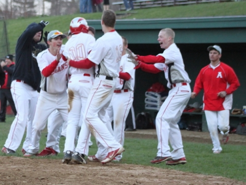 Adam Ivancic (00) is mobbed after scoring the winning run