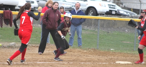 Lauren Singer, caught in a rundown, escaped and later scored as Coach Lori Solazzo looks on.