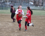 Erin Campbell congratulated after making a nice play at second