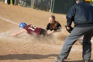 Lauren Singer is tagged out at home by pitcher Tyler Feeney.