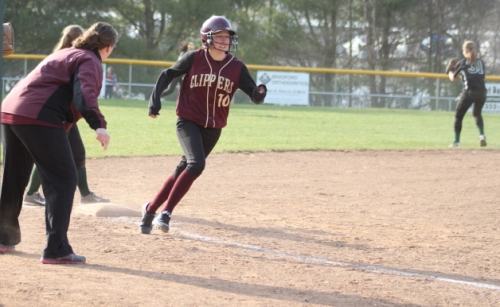 Newburyport coach Lori Solazzo sends Molly Stanton home in the seventh inning.