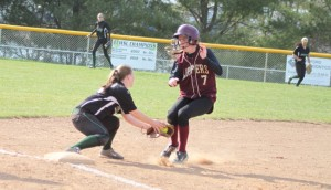 Megan Haley tags out Kendra Dow at third.