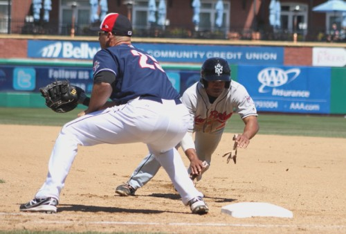 Antoan Richardson dives back as Clint Robinson waits for a throw during the New Hampshire/New Britain game on April 25th.