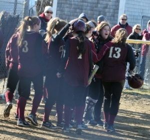 Casey Barlow (#13) gets congratulated after her two-run blast