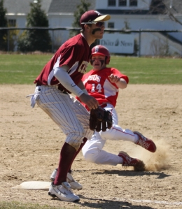 Shane Ripley starts his slide into third as Colton Fontaine waits for a throw