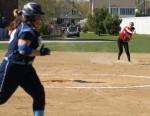 Shortstop Amanda Schell fires to first