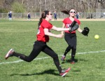 Lauren Fedorchak and Jenn Bartley chase a foul ball