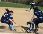 Rylee Culverwell and Julia Hartman pursue a bunt