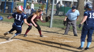 Mara Spears slides home (safely) as Carley Siemasko waits for throw