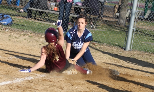 Mara tags Vicki out to end the seventh inning