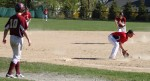 Zack Fitzgerald fields a grounder as Ian Michaels races to third