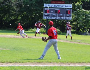 Luis Atiles throws wide to first allowing the first Clippers run in the second inning