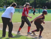 Carley Siemasko tags up as leftfielder Allison Kapoll prepares to throw to the plate