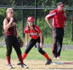 Carley Siemasko, McKenzie Joyce and Coach John Gold in the 7th inning