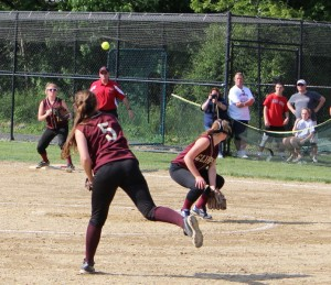 Third baseman Meghan Stanton throws a strike to first