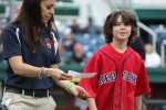 youngster outruns mascot to get prize