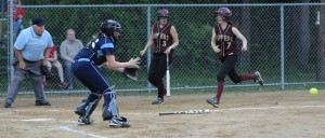 Catcher Julia Hartman waits for the throw as Kendra Dow tries to score.