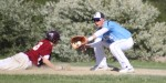 Colby Morris slides back to first as Adam Chatterton waits to apply the tag