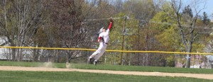 Shortstop Ben Cullen leaps for a high bouncer