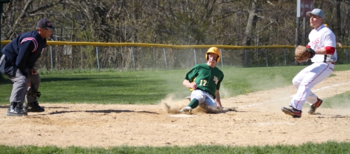 Ryan McAuliffe scores on a wild pitch