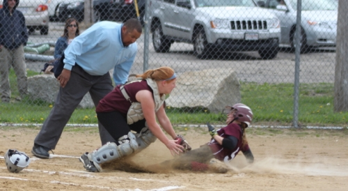 Catcher Shelby OBrien gets Hannah Lorden at the plate.