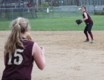 Kendra Dow throws to first