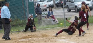 Meghan Stanton gets home on a wild pitch