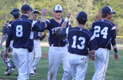Triton pitcher Nick Cornoni gets congratulated after his complete-game win.