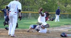 Nick Desrocher sends Amesbury catcher Mac Short flying