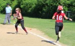 Carley Siemasko drops a popup but recovers quickly to tag out Amanda Schell
