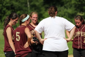 NHS coach Lori Solazzo visits the mound