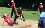 Jenna Bartley scores the sisth run for Amesbury on a wild pitch