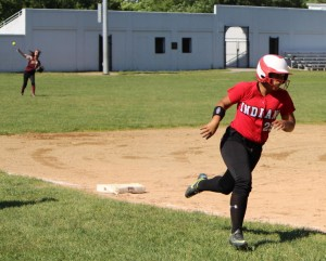 Ashley Valme heads for home as Kendra Dow throws from the outfield