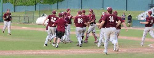 Whittier teammates gather around winning pitcher Andrew Wells