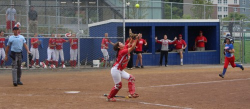 Catcher Krista Toscano eyes the final out as Meaghan McLaughlin runs for the plate