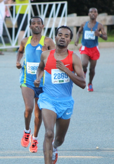 Aschalew Mekete wins with fellow Ethiopians Mengistu Nebsi and Tariku Bokan close behind.