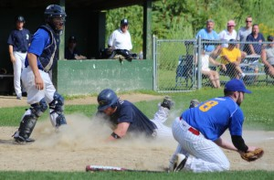 Nate Bertolino slides in with the fifth ME run