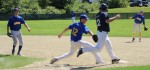 Ian Buckley beats pitcher Joe White to first