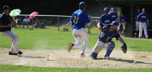 Drew Carter crosses home with the eventual game-winner in the sixth inning