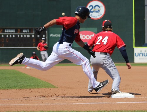 Peter Hissey hustles to beat the throw to first enabling the Portland Sea Dogs to score their first run.