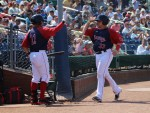 Christian Vazquez gets high five from Shannon Wilkerson after scoring first run
