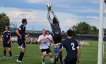 GK Josh McDuffie leaps to save