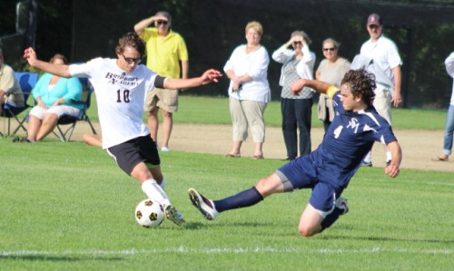 Connor Reagan (2 goals) eludes defender Zach Napsey in the first half